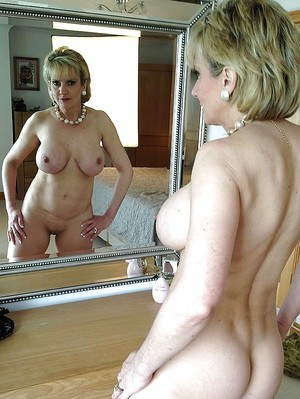 Salacious mature lassie exposing her tempting body with big round boobs