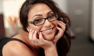 Smiley schoolgirl in glasses Rikki Nyx revealing her voluptuous curves
