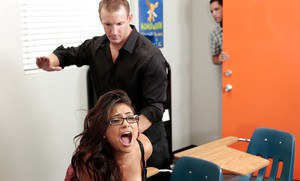Latina schoolgirl Rikki Nyx gets spanked and fucked in the classroom