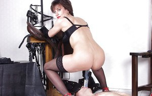 Nasty mature femdom in stockings has some fun with her blindfolded male pet