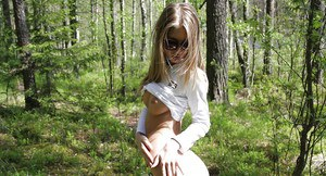 Slippy long-haired amateur flashing her petite tits outdoor