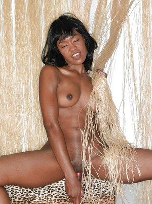 Naughty ebony cutie slipping off her bikini and toying her hungry pussy