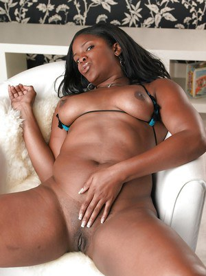 Chubby ebony lassie in bikini revealing her bosoms and inviting pussy