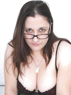 Busty mature gal in glasses takes off her peignoir and rips her pantyhose