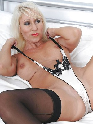 Fuckable mature blonde with huge jugs stripping and spreading her legs