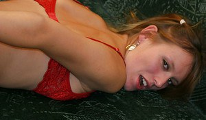 Saucy amateur in red lingerie and stockings exposing her cherry hole