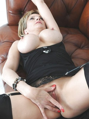 Mature blonde with no lingerie under her dress teasing her juicy slit