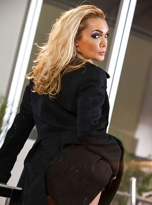 Shapely blonde MILF taking off her formal suit and lingerie