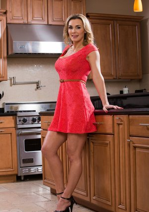 Well-graced MILF on high heels Tanya Tate stripping in the kitchen