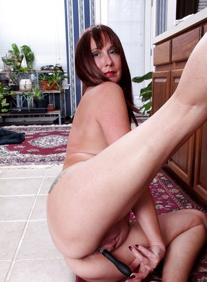 Sassy mature lady on high heels toying her hungry cunt in the kitchen