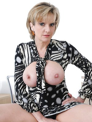 Frisky mature lady showcasing her amazing big tits and hot fanny