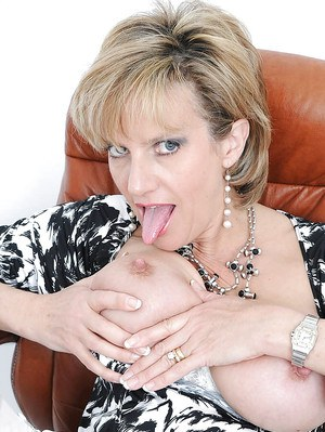 Lusty mature bombshell licking her hard nipples and teasing her juicy cunt