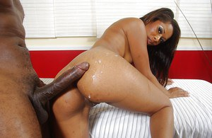 Slippy ebony gal Cali Sweet gets screwed and takes a cumshot on her fanny