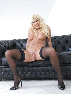 Sassy mature blonde with big jugs stripping and rubbing her clit