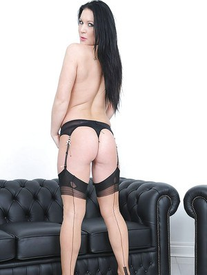 Hot ass mature brunette in stockings reveals her big cans and bald cunt
