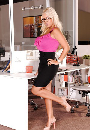 Busty office lady in glasses Bridgette B. slipping off her suit and lingerie