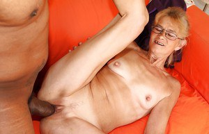 Sassy granny in glasses gets her pussy licked and cocked up by a black guy