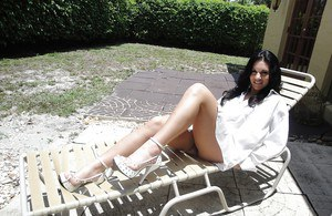 Raven-haired amateur Bella Reese demonstrating her goods outdoor