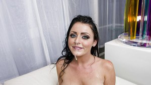 Sophie Dee enjoys double penetration and takes a double facial cumshot