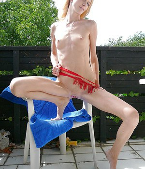 Slippy blonde amateur with long legs gets rid of her lingerie outdoor