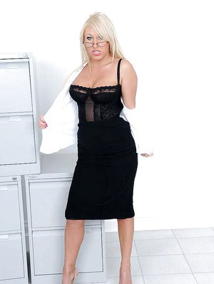 Fuckable mature blonde in glasses gets rid of her formal suit and lingerie