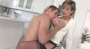 Saucy mature vixen fucks a younger cock and gets facialized