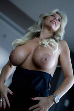 Sassy blonde wife in tiny dress revealing her big round bosoms