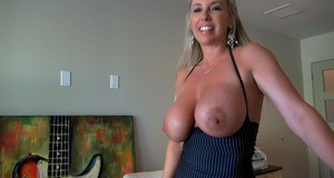 Voluptuous mature blonde in tiny dress revealing her amazing big bosoms