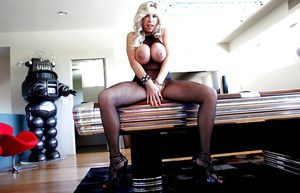 Leggy MILF with huge cans posing in erotic pantyhose suit