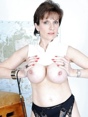 Bottomless mature fetish lady in stockings reveals her big round jugs
