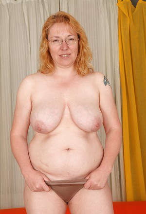 Chubby redhead mature gal with big flabby jugs getting naked