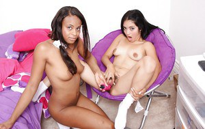 Dainty girl has some lesbian fun with her ebony friend using her sex toys