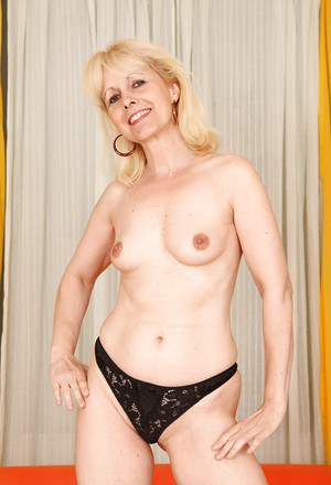 Lusty blonde granny Koko Blond gets rid of her dress and panties