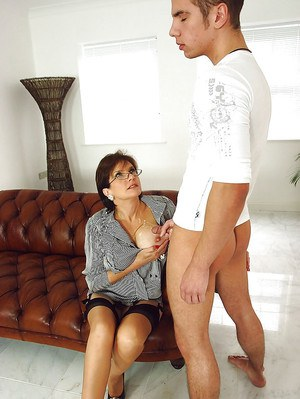 Lecherous mature lady in glasses gets her big round breast glazed with cum