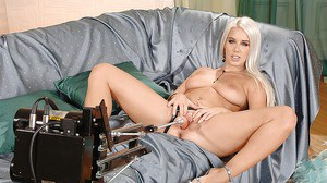 Sensuous blonde babe gets her pussy satisfied by a fucking machine