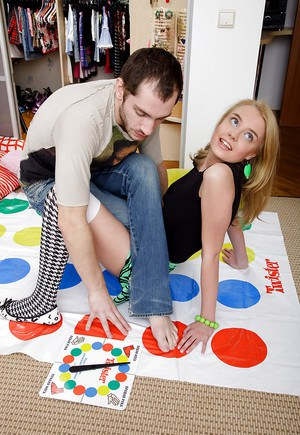 Foxy teen enjoys a twister play turning into passionate pussy pounding