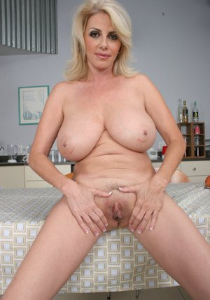 Deep-bosomed mature lady Penny Porsche gets rid of her dress and lingerie