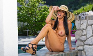 Ravishing MILF Vanilla DeVille stripping off her clothes outdoor