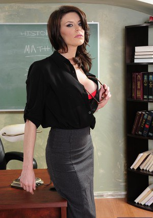 Steaming hot teacher with long legs stripping in the classroom