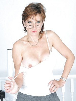 Filthy mature gal revealing her goods and playing with a fucking machine