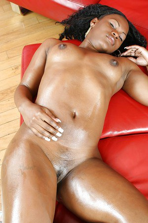 Oiled up ebony lassie Megan Pryce stripping and fingering her pussy