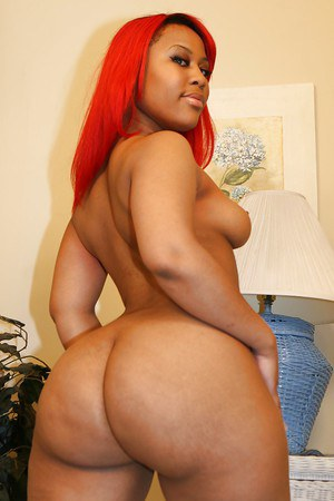 Bootylicious ebony chick gets rid of her red lingerie and stockings