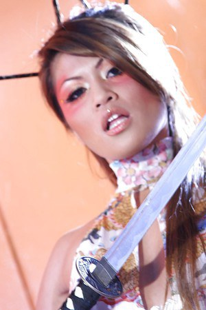Glamourous asian lady Charmane Star revealing her perky tits