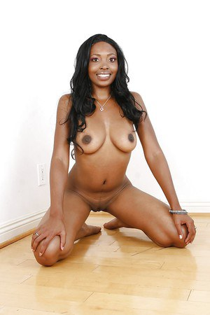 Smiley ebony hottie on high heels slipping off her sexy lingerie