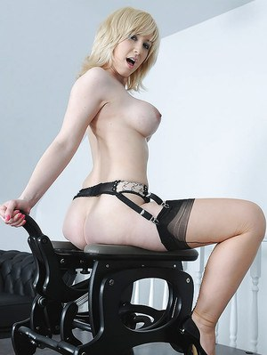 Full-breasted blonde MILF in stockings riding a fucking machine