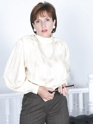 Mature fetish lady taking off her formal trousers and high-heeled shoes