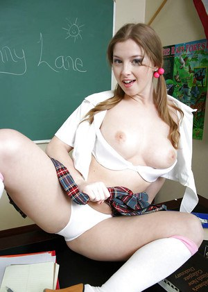 Naughty schoolgirl with pigtails Sunny Lane revealing her seductive curves