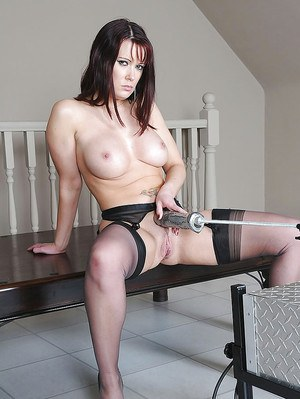 Busty mature vixen in stockings has some dirty fun with a fucking machine