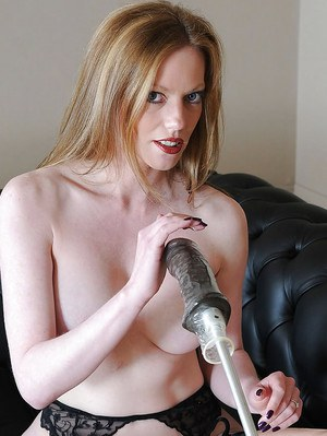 Stunning mature lady in stockings playing with a fucking machine dildo