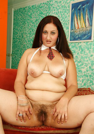 Mature latina lassie Sonia Blaze revealing her jugs and shaggy cunt